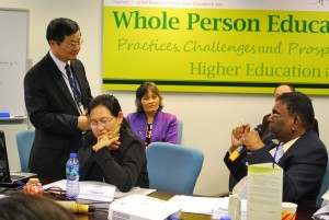 Philip Leung, left, shares ideas on whole person education.